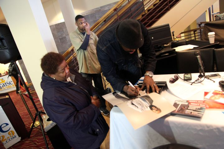 Marcus D. Wiley Signs Autographers