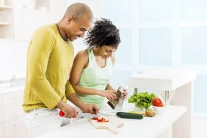 Couple preparing food in kitchen.